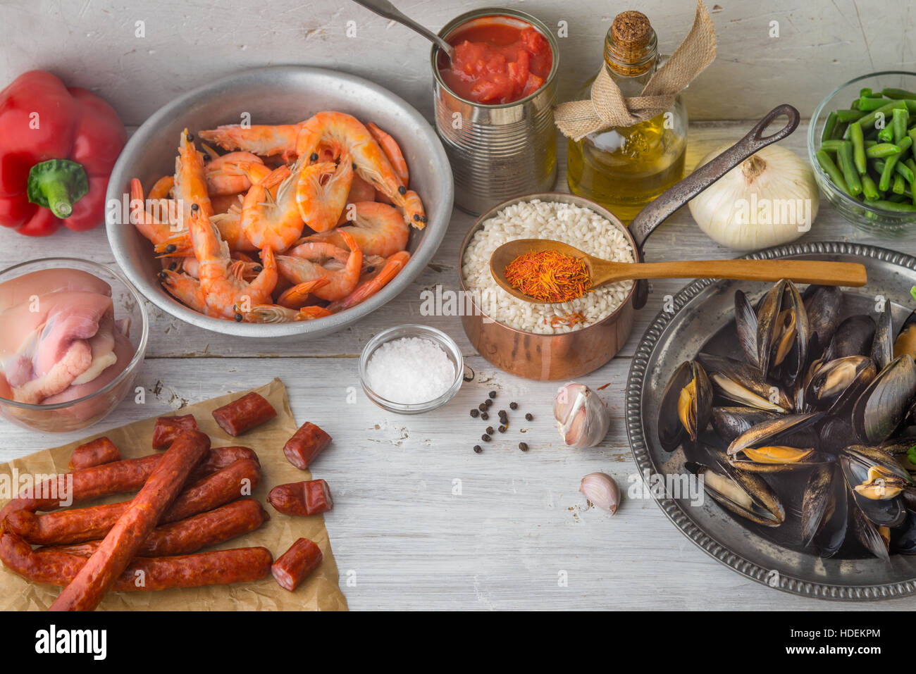 Ingredients for paella on the white scratched table - Stock Image
