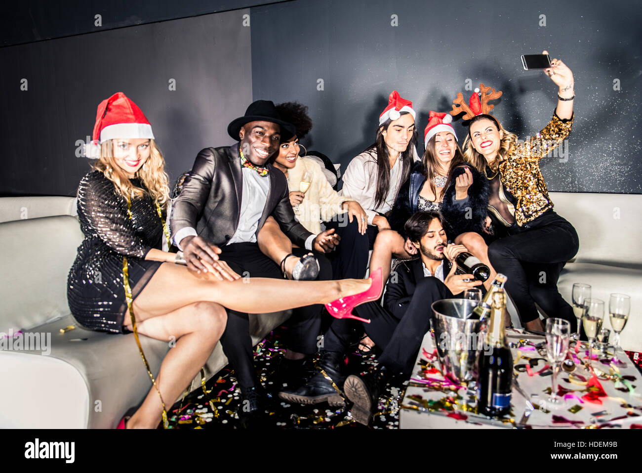 Multi-ethnic group of friends celebrating the end of the year in a nightclub - Sylvester party, clubbers having Stock Photo
