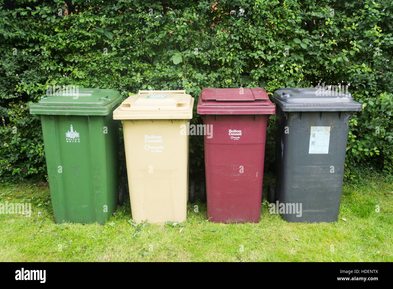 Bolton Council domestic waste and recycling bins for garden waste, food scraps, paper, card, cans,  bottles and Stock Photo