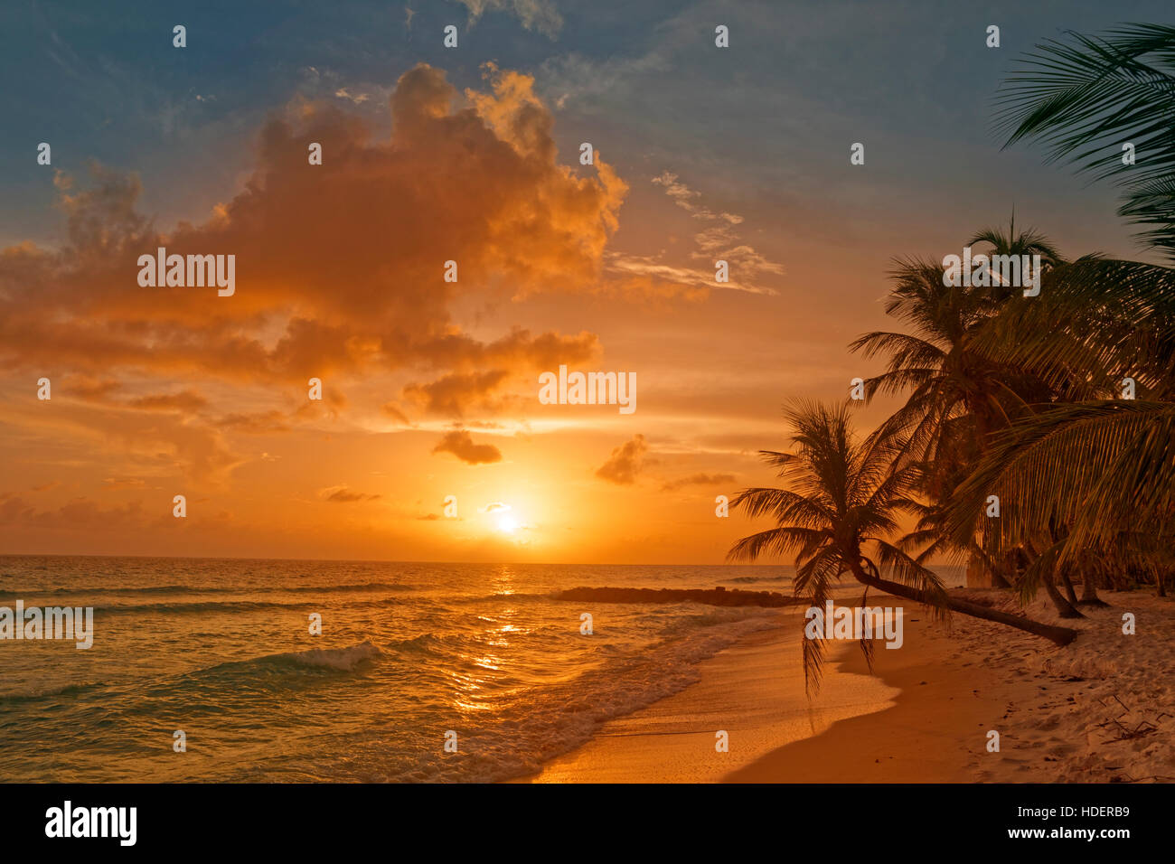 Sunset at Dover Beach, St. Lawrence Gap, South Coast, Barbados, Caribbean. - Stock Image