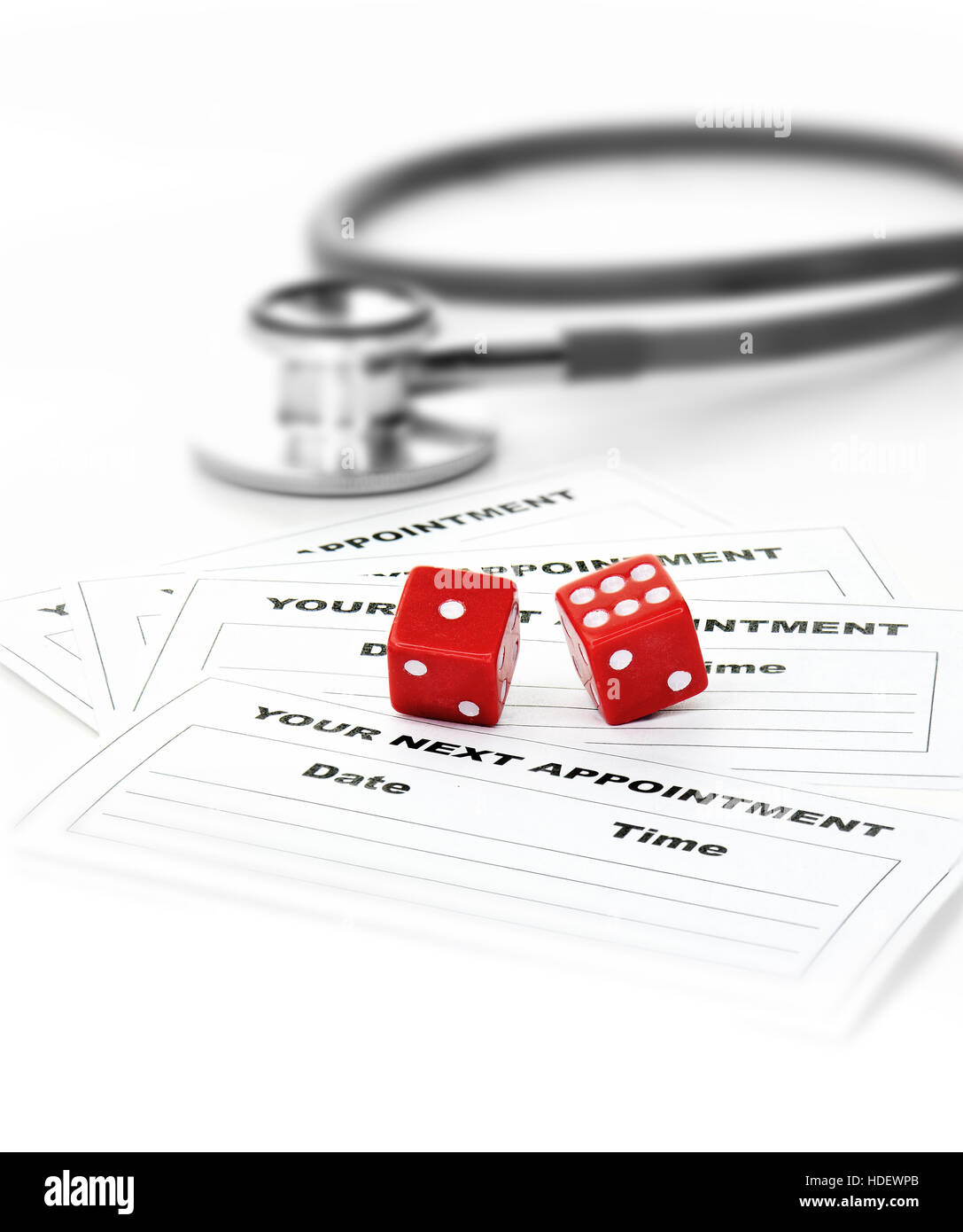 Two Red Dice Stethoscope And Blank Appointment Cards Against A Light Background With Copy Space Concept Image For Postcode Lottery Health Care Rece