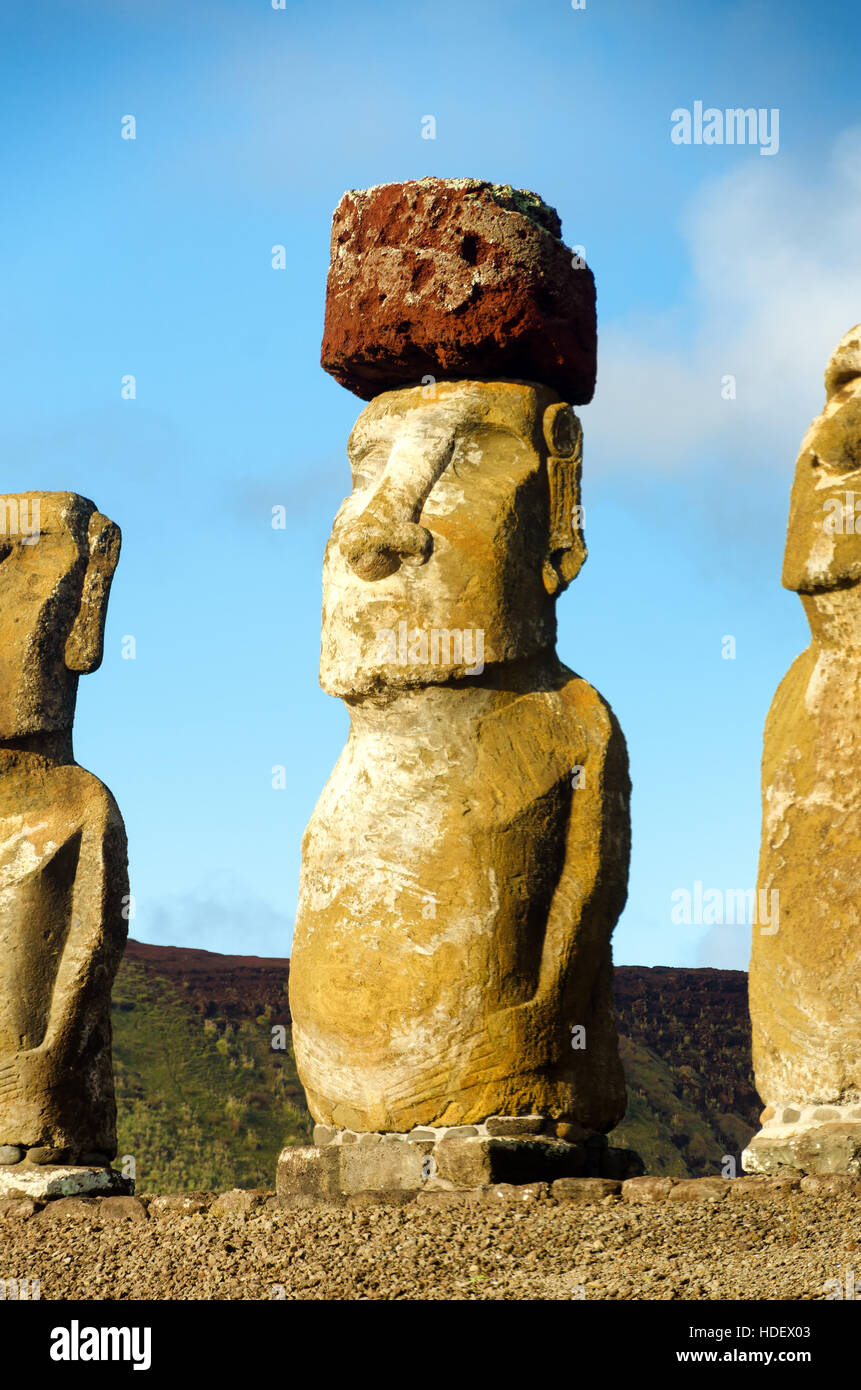 Moai closeup on Easter Island, Chile.  The red stone on its head is called a pukao - Stock Image
