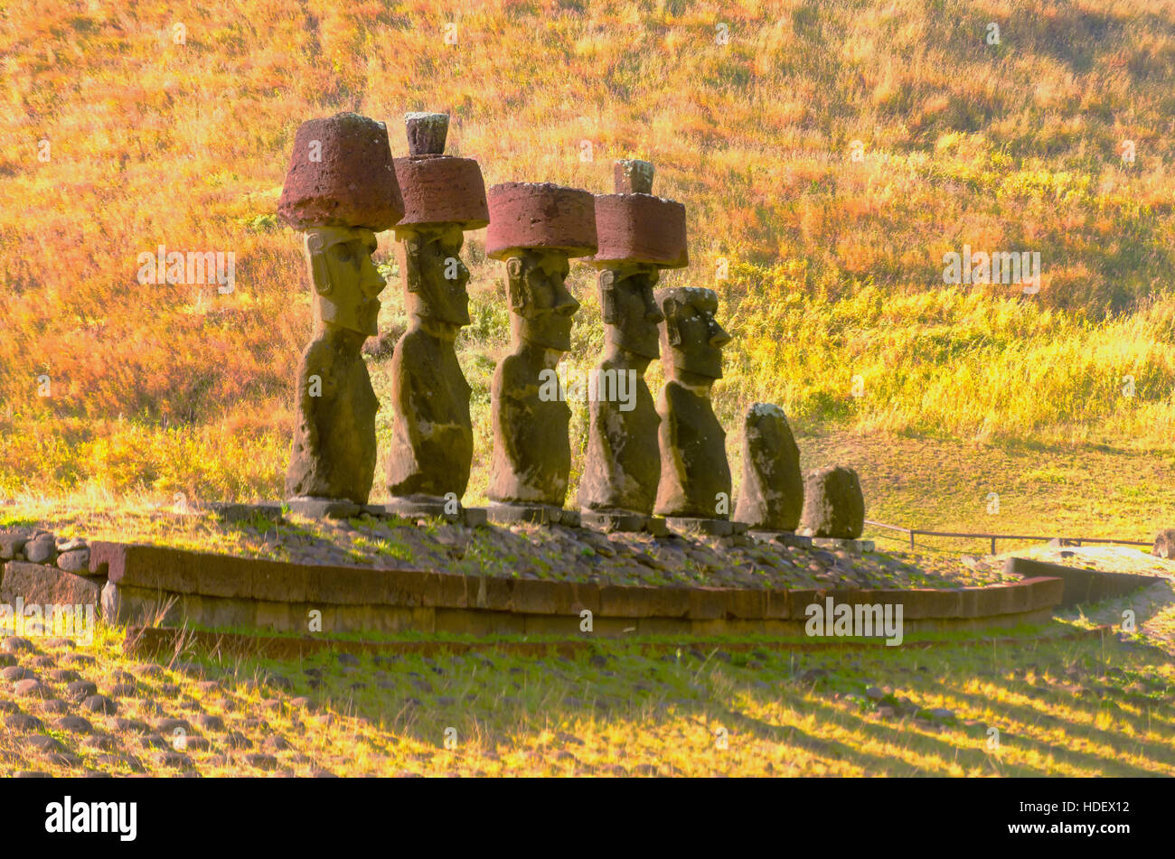 Moai statues wear Pukaos at Anakena Beach on Easter Island in Chile - Stock Image