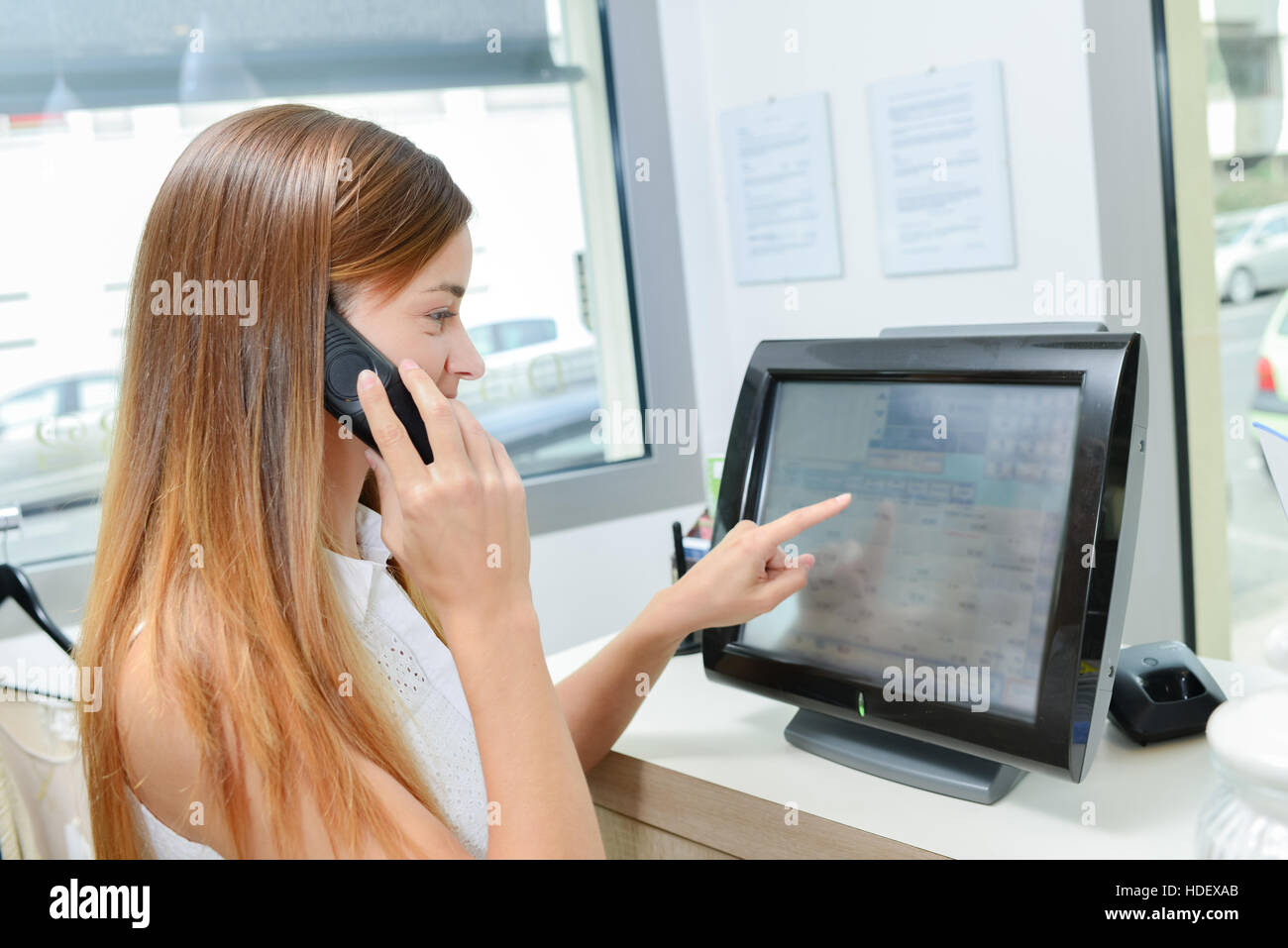 Young woman operating a till Stock Photo