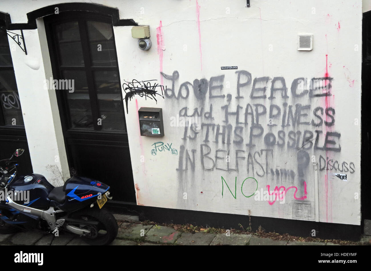 Love, Peace and Happiness,Is this possible in Belfast? Discuss - Stock Image
