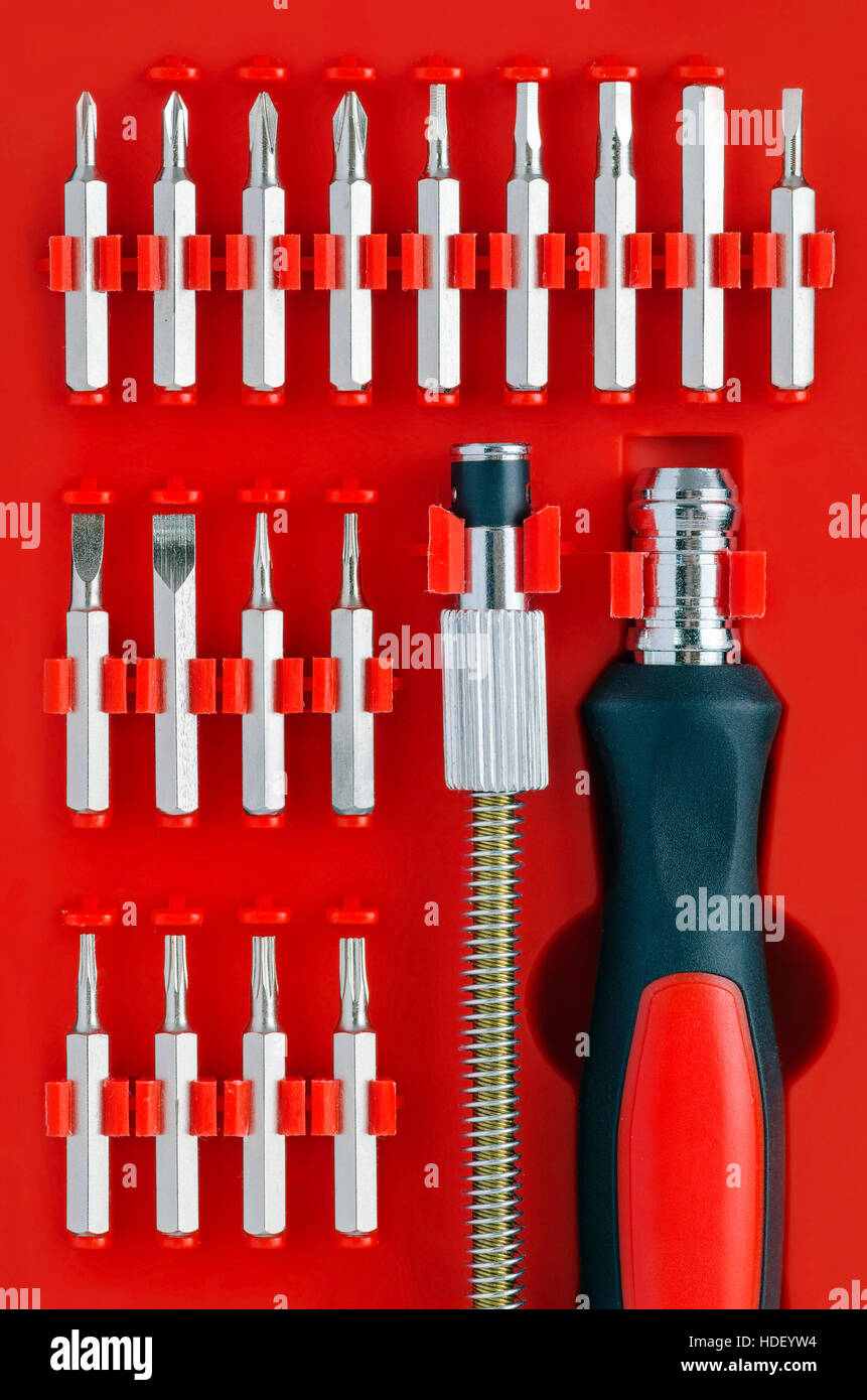 Screwdriver Kit on Red Background - Stock Image