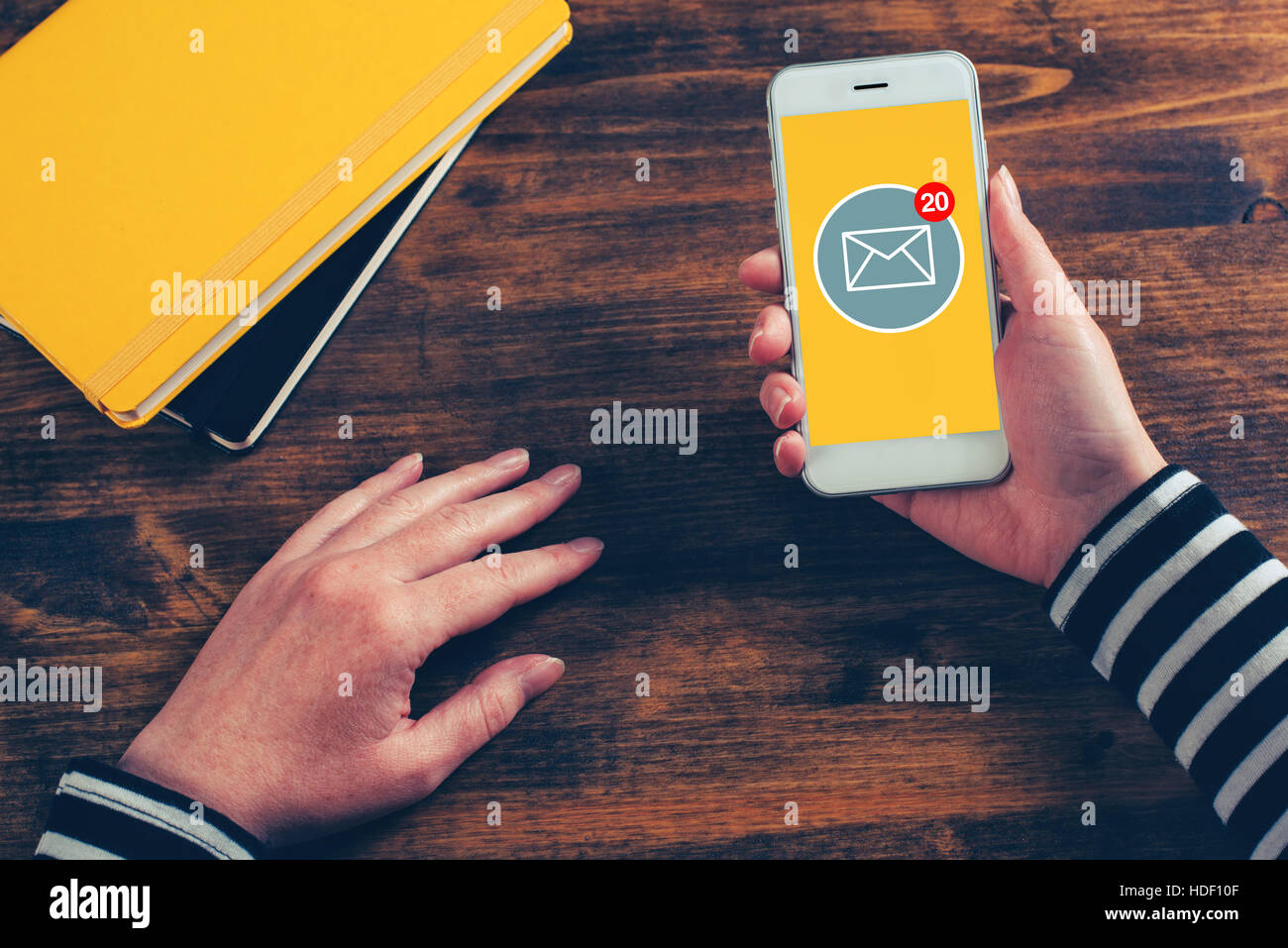 SMS receive notification on smartphone screen, female hands using mobile phone - Stock Image