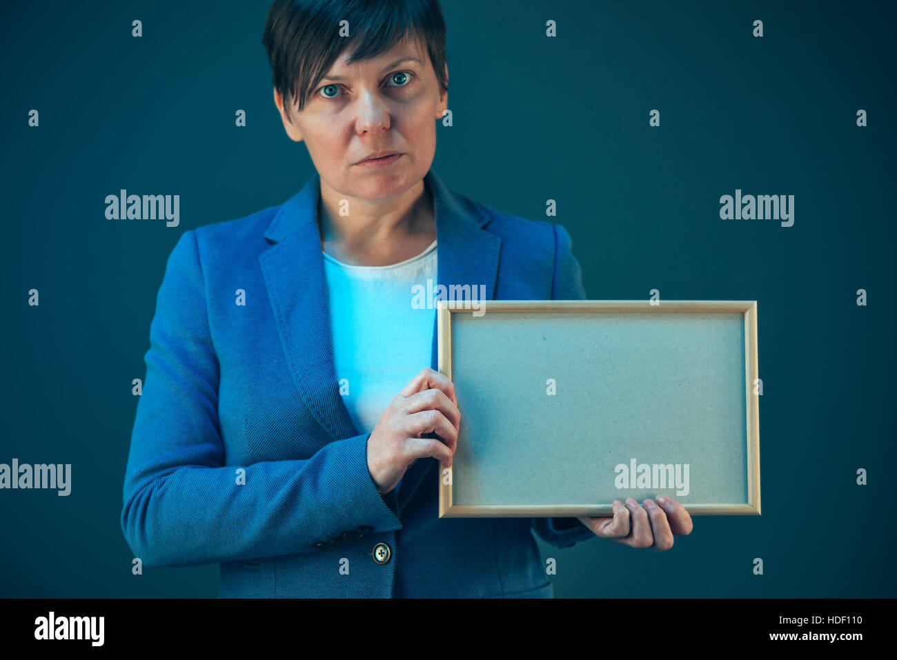 Business woman holding blank diploma certificate as mock up copy space - Stock Image