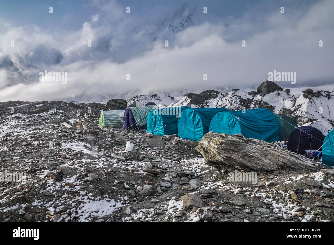 Photo of blue tents of hikers near South Inylcheck Glaciar in Kyrgystan. - Stock Image