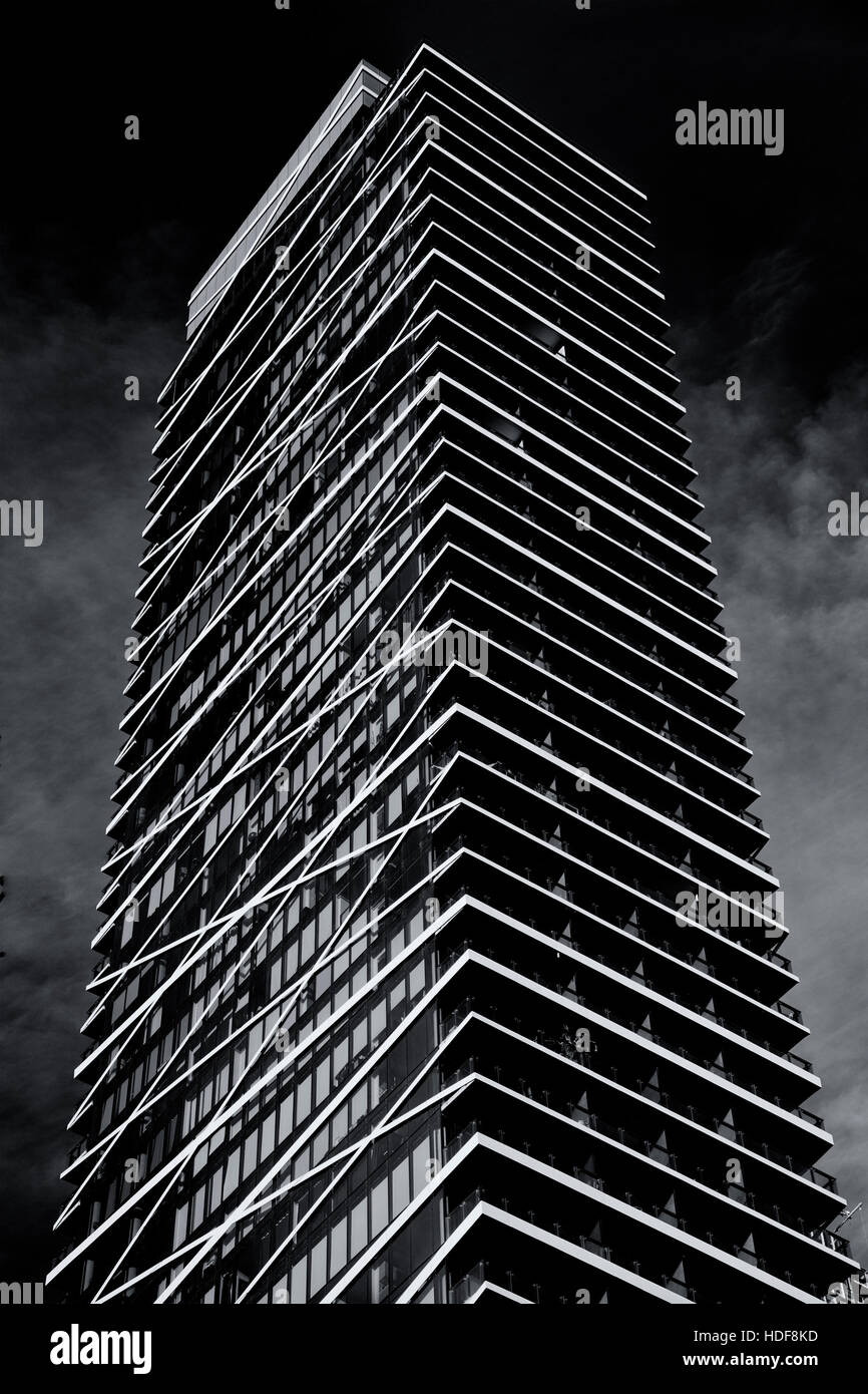 condominium skyscraper tower on King Street in Toronto in monochrome showing exterior architectural details - Stock Image