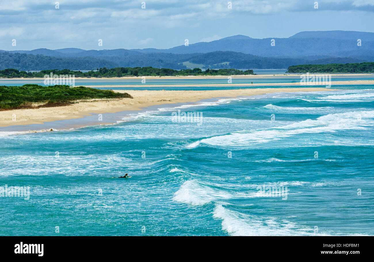 Lone surfer in large waves at Bastion Point, Mallacoota, Victoria, VIC, Australia - Stock Image