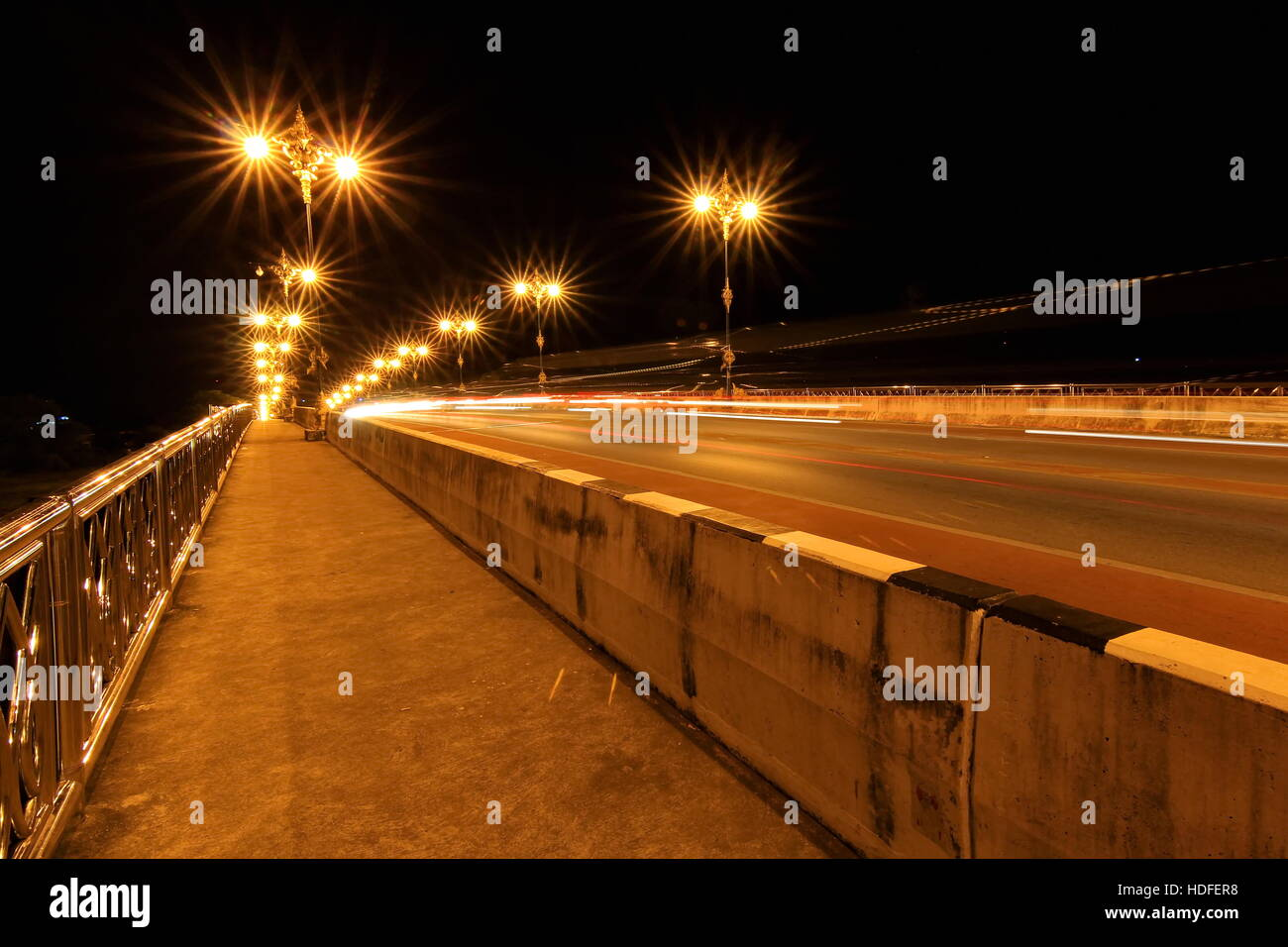 Nightscape of Phaya Mang Rai Bridge in Chiang Rai, Thailand - Stock Image