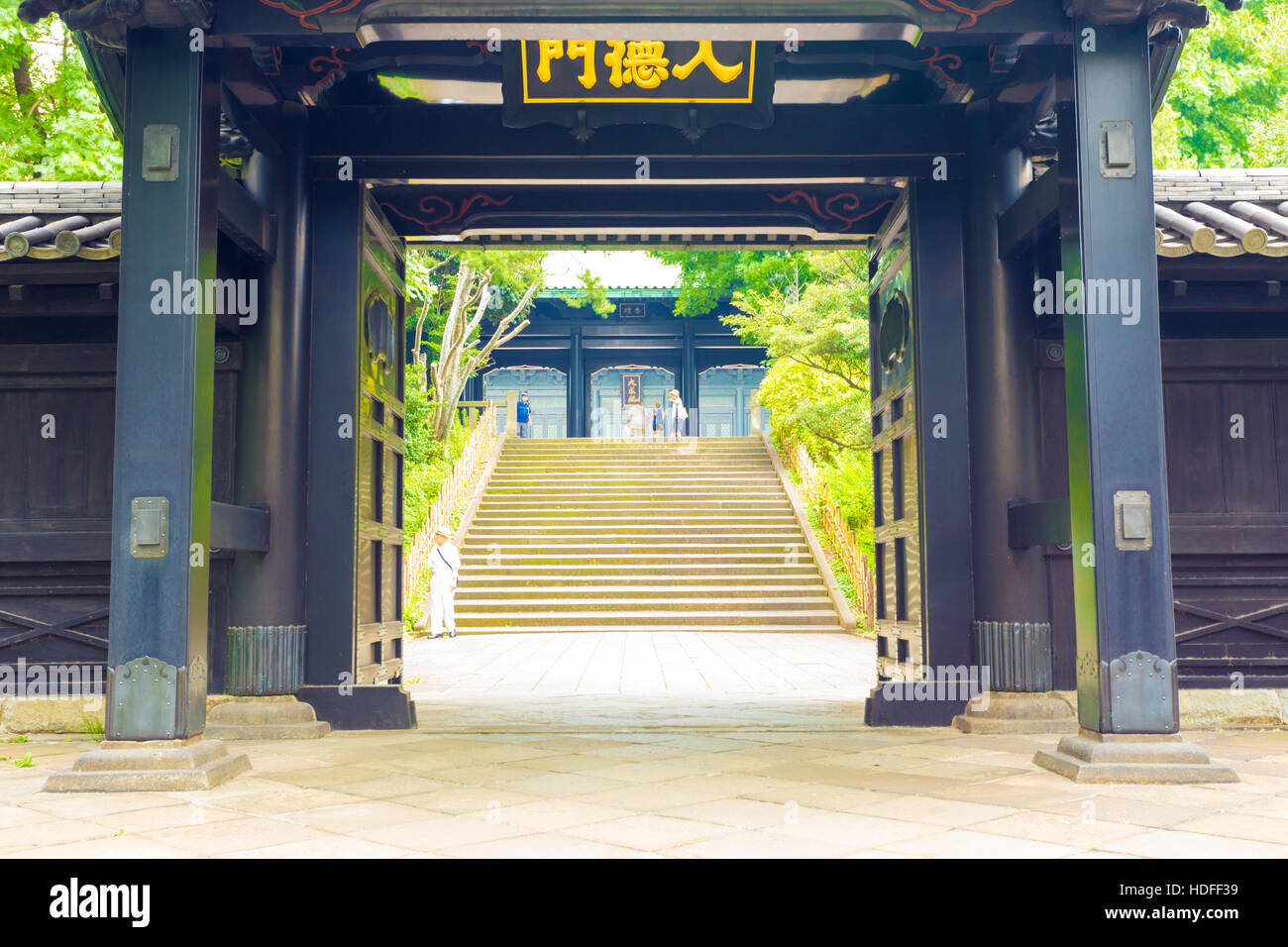 Stairs seen through open entrance doorway to historic Yushima Seido, a Confucian temple in Tokyo, Japan. Horizontal - Stock Image