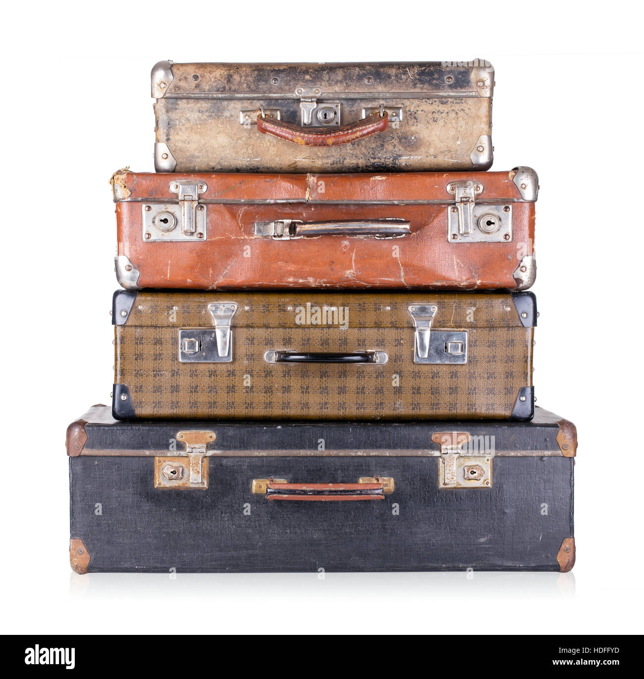 A stack of old suitcases isolated on white background - Stock Image