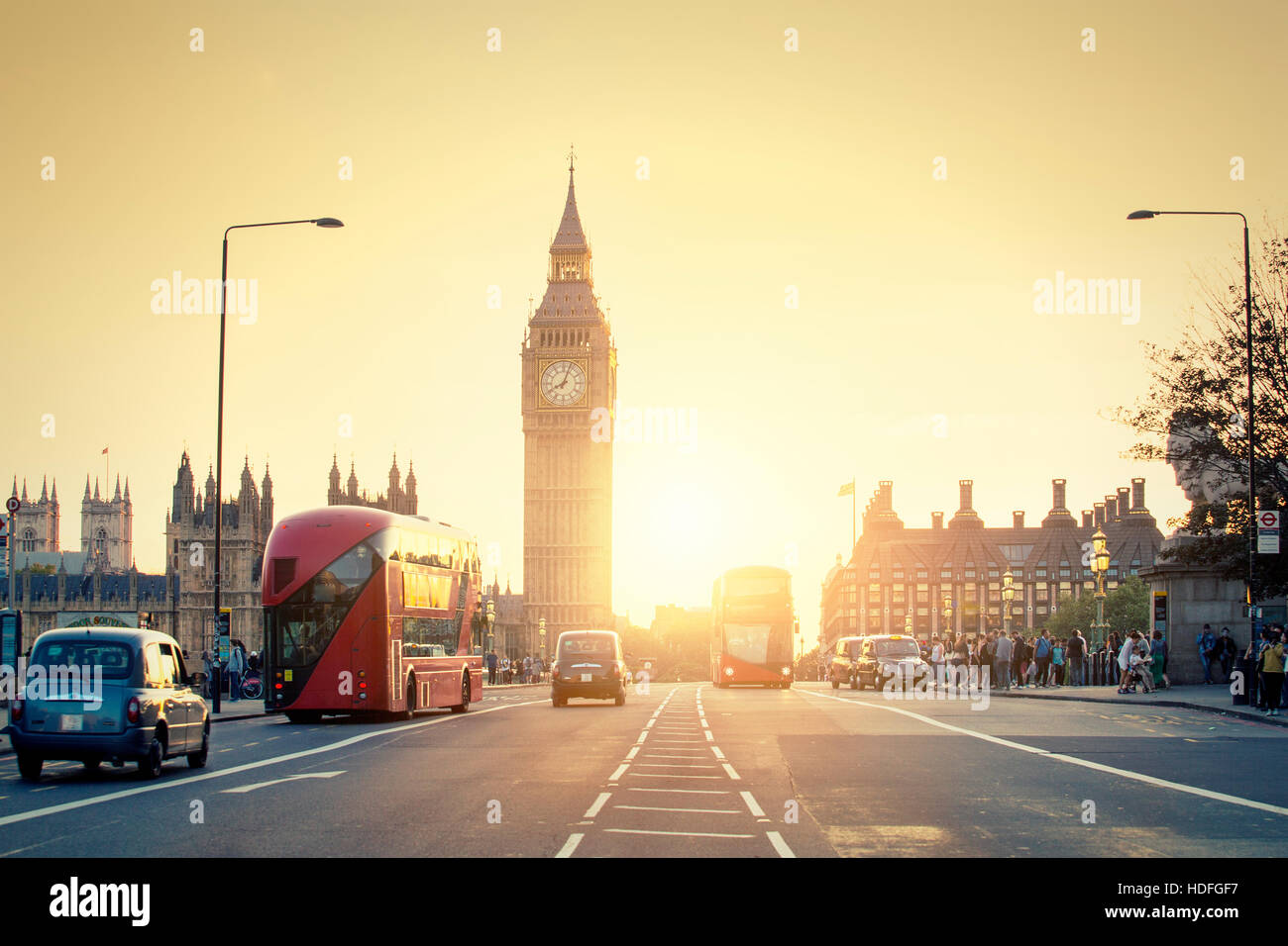 LONDON, UNITED KINGDOM,  Westminster palace and Big Ben and traffic on Westminster bridge in foreground - Stock Image
