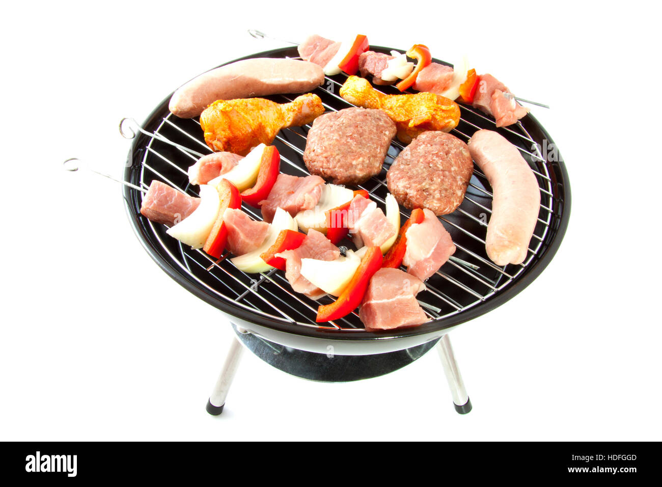 Different kind of meat on a bbq isolated over white - Stock Image