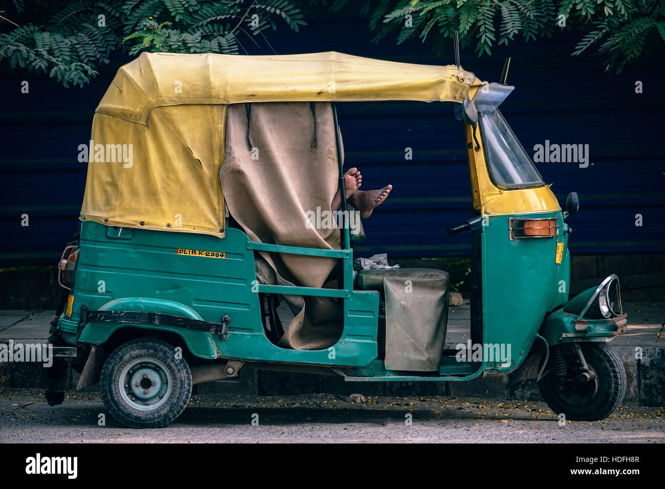 Auto-rickshaws ensure connectivity and easy access throughout congested Indian cities - Stock Image