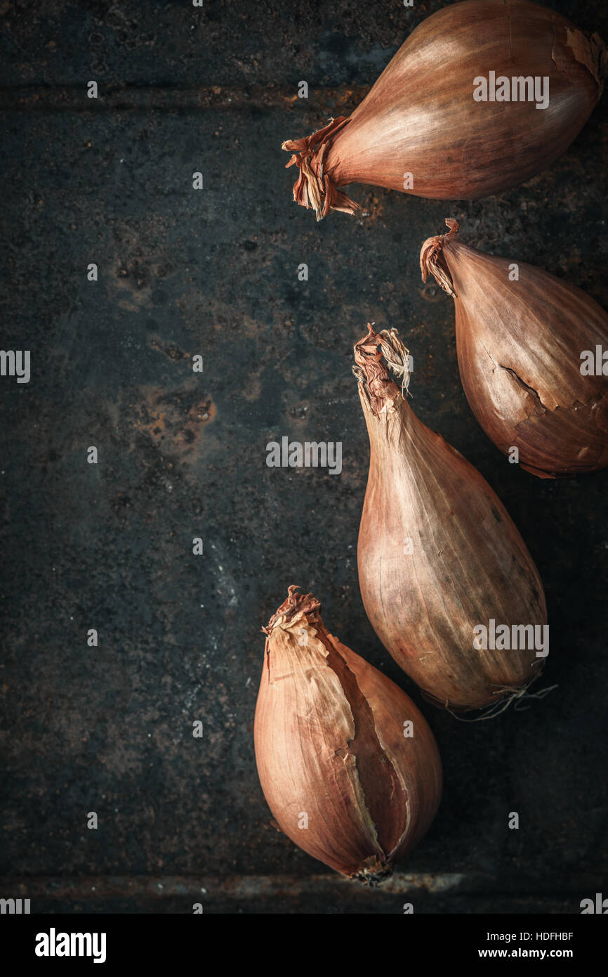 Shallots  on the  old metal background  vertical - Stock Image