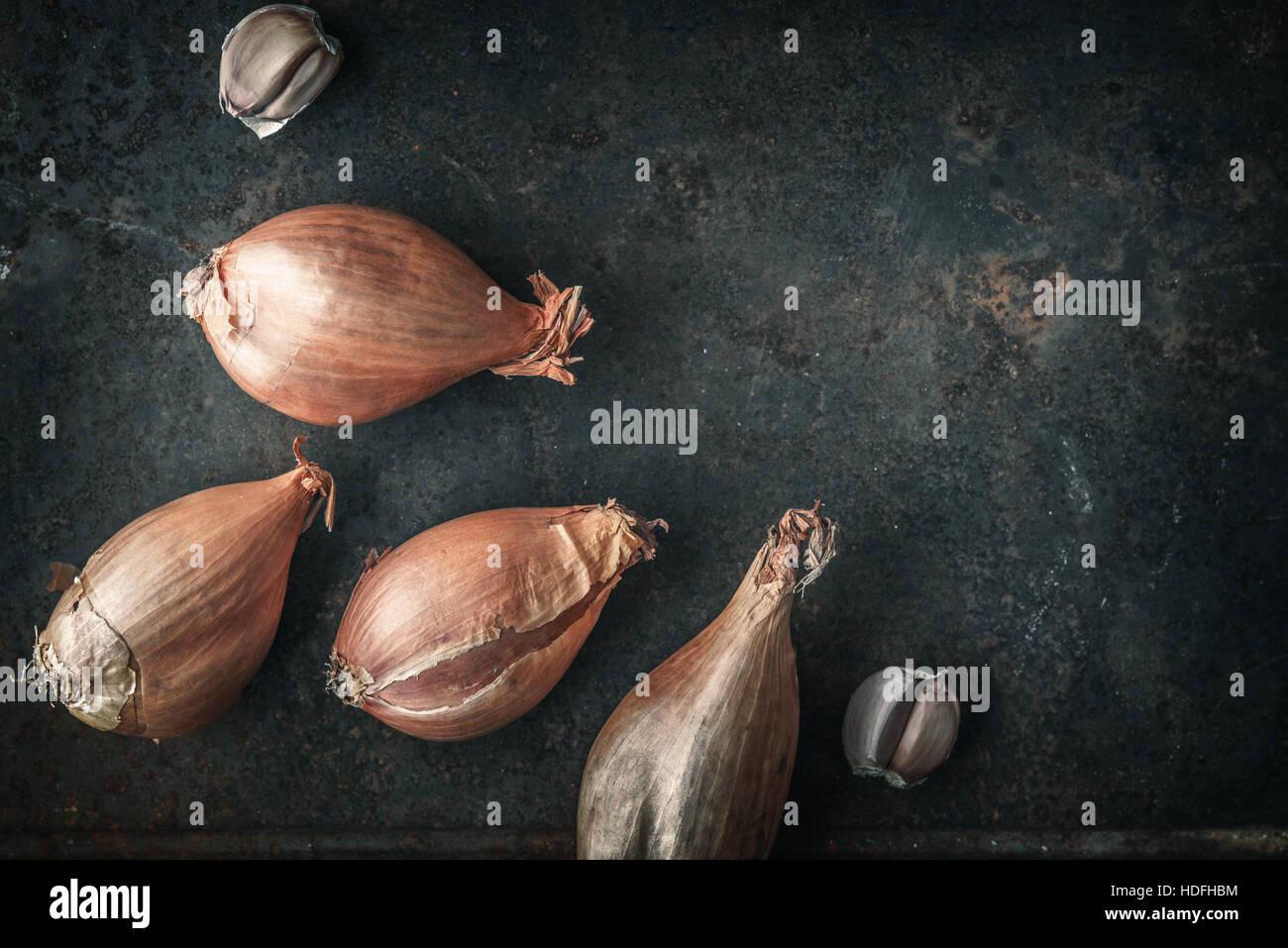 Shallots  on the  old metal background  top view - Stock Image