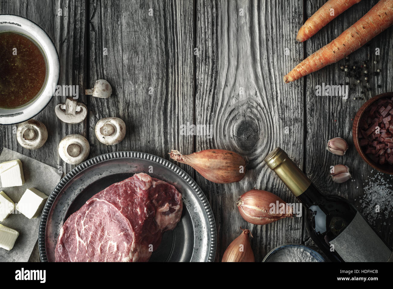 angus beef marble meat hip thigh raw onion - Stock Image
