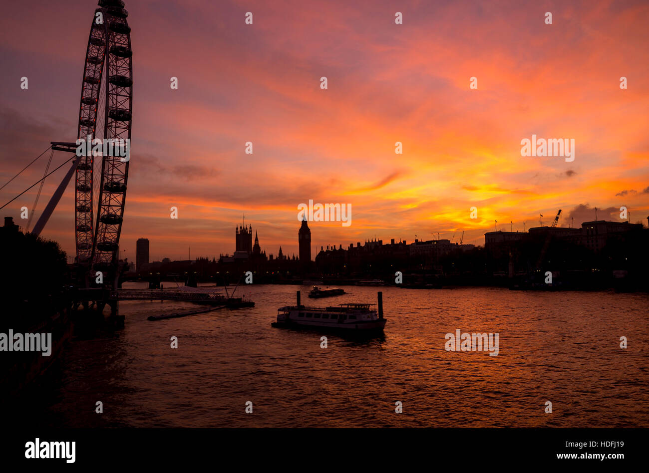 Beautiful view of London Skyline with London Eye and Westminster along Thames River - Stock Image