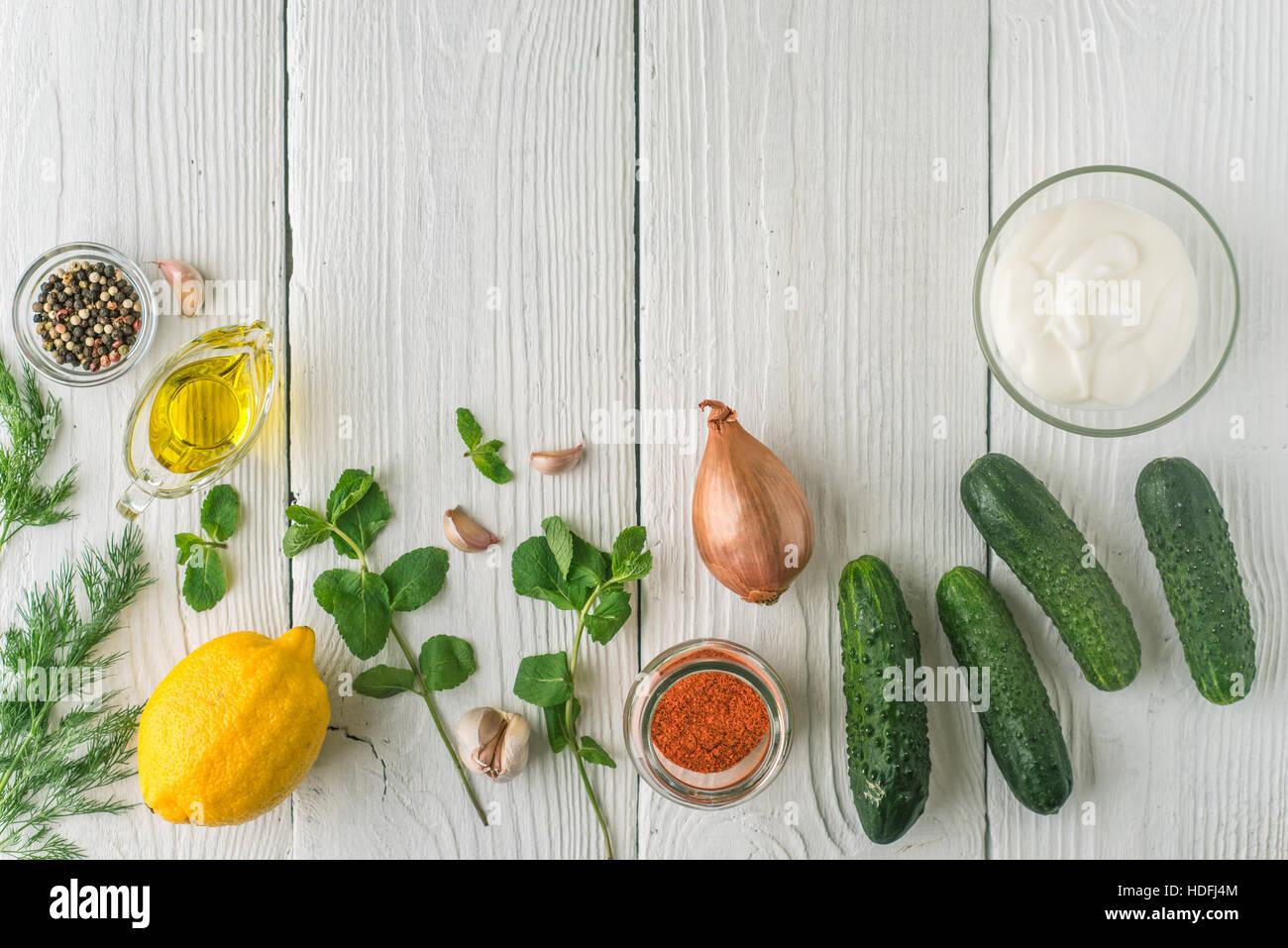 Ingredients for tzatziki on the white wooden table horizontal - Stock Image