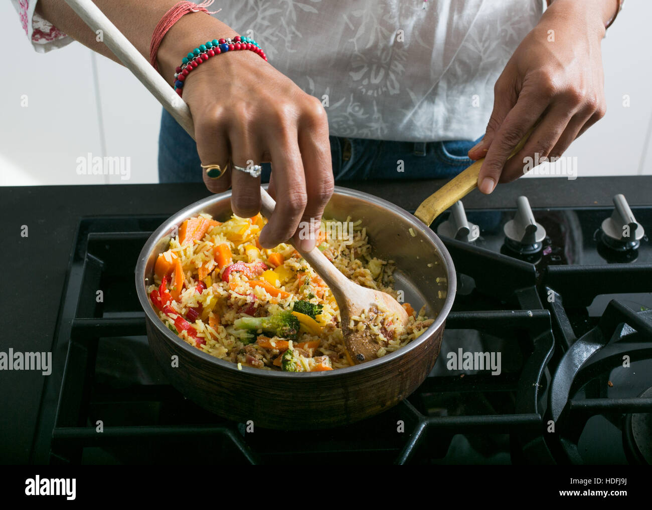 Young indian woman in a kitchen preparing ayurvedic food stock photo young indian woman in a kitchen preparing ayurvedic food forumfinder Choice Image
