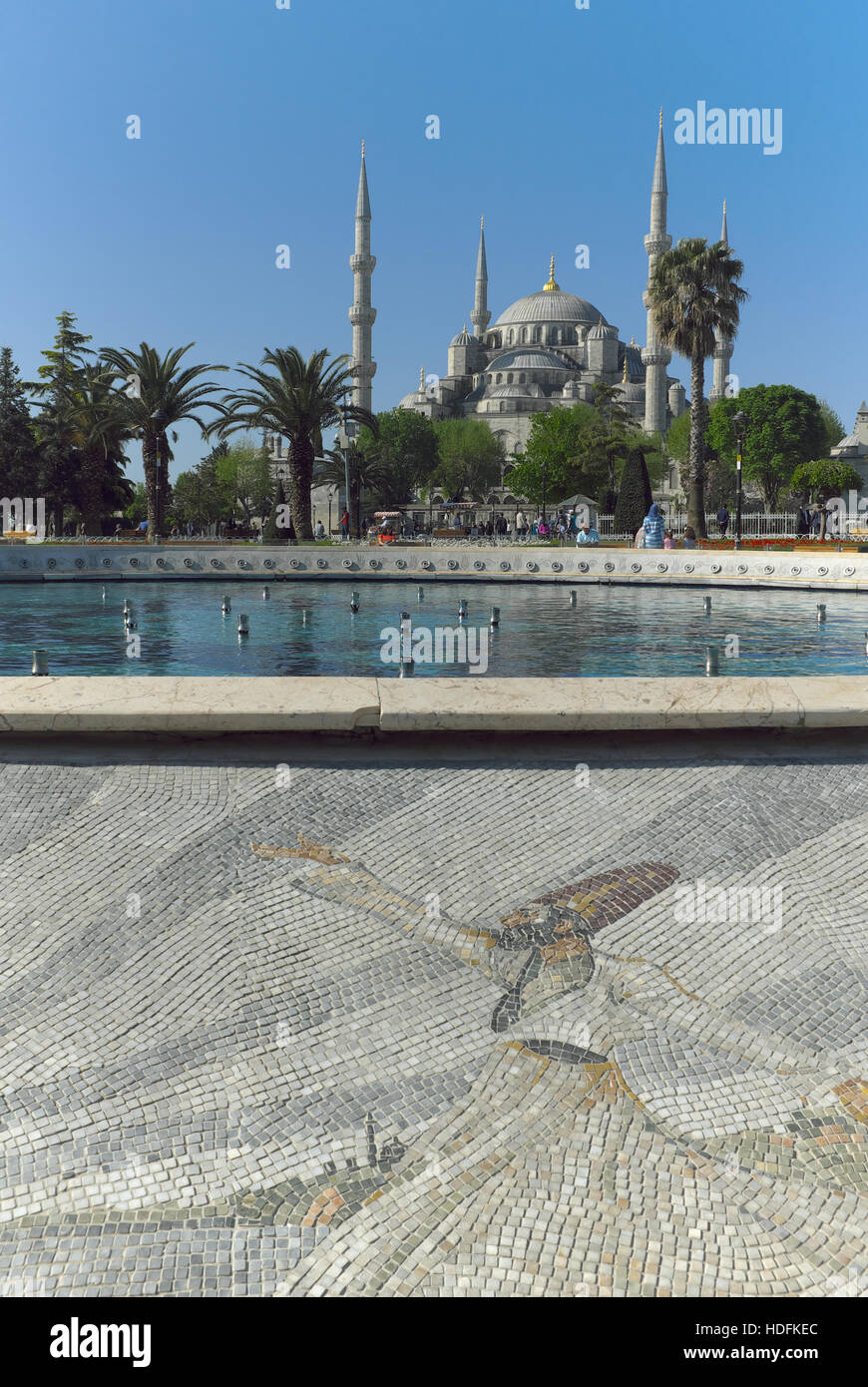 Istanbul, Turkey with the Hagia Sophia in the background and a fountain surrounding by a mosaic whirling dervish - Stock Image