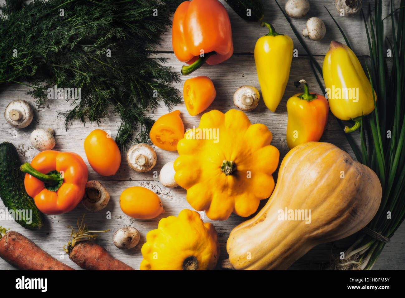 Yellow and green vegetables on the white wooden table horizontal - Stock Image