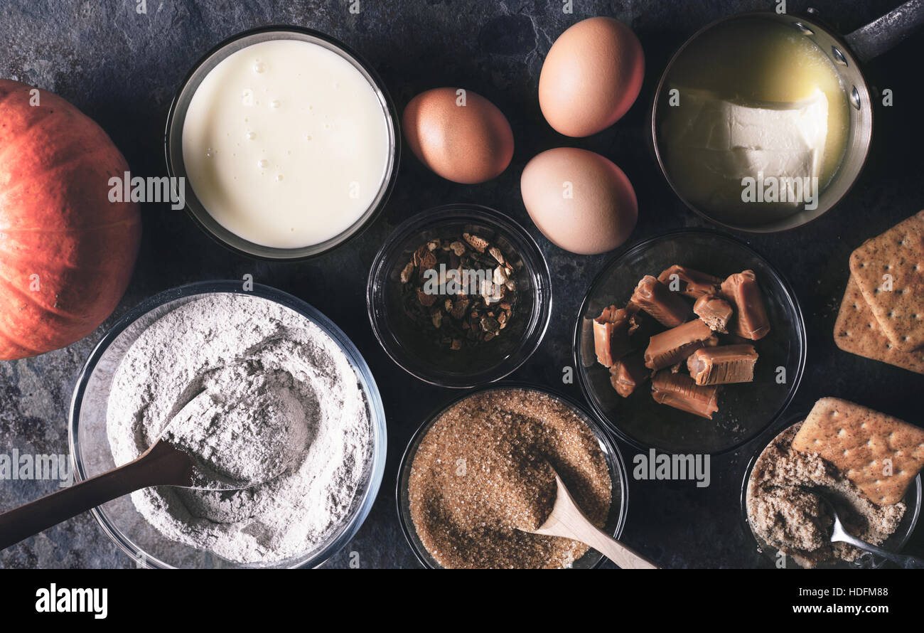 Ingredients for  pumpkin dump cake on the dark stone background top view - Stock Image