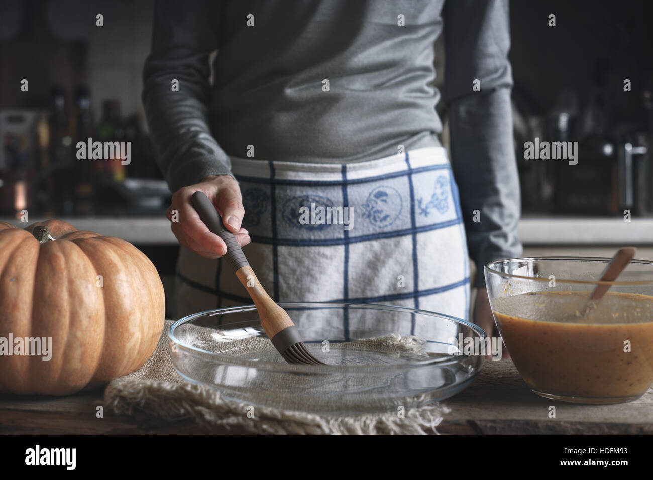 Oiling the backing dish for pumpkin dump cake - Stock Image