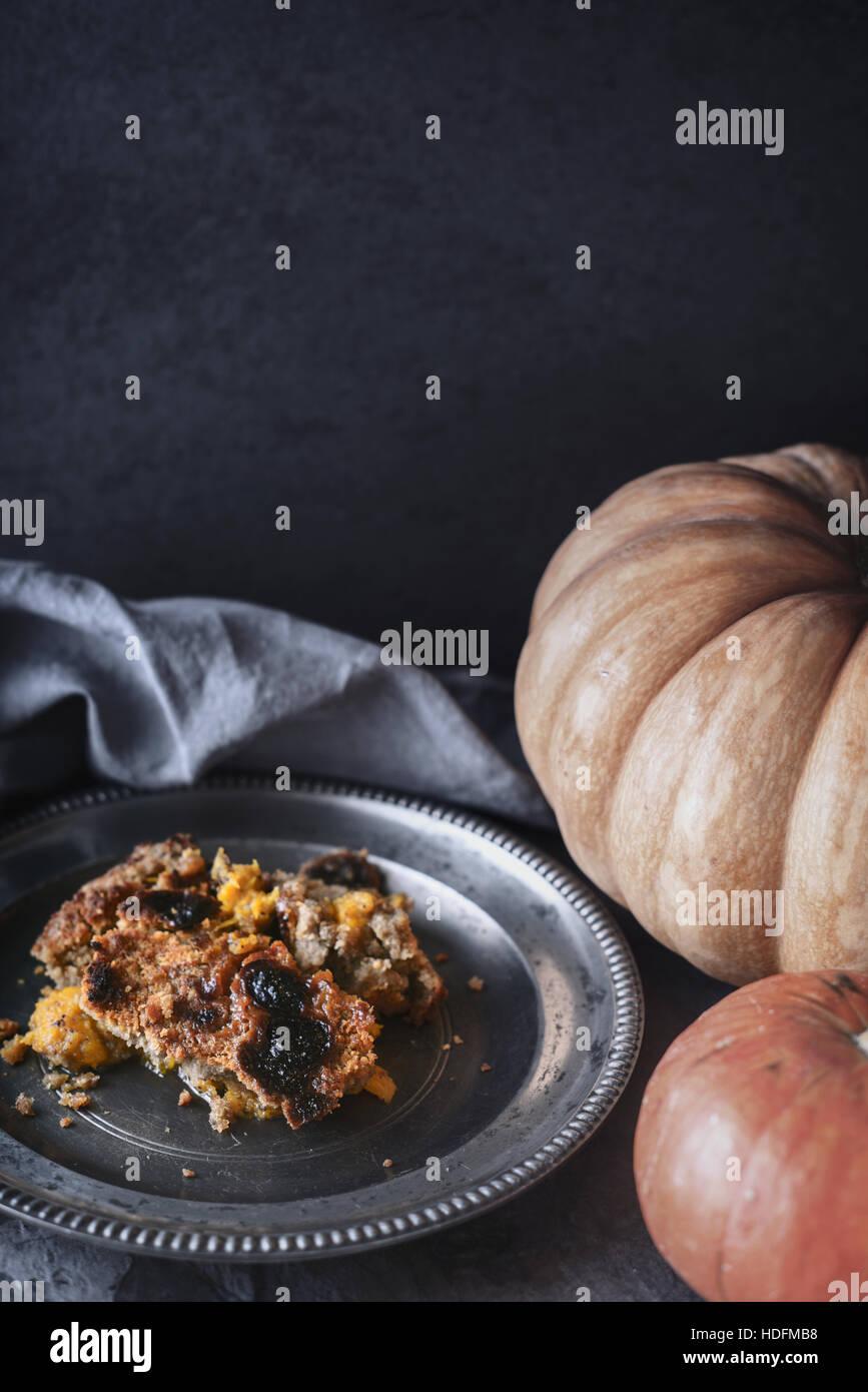 Pumpkin dump cake on the metal plate  vertical - Stock Image