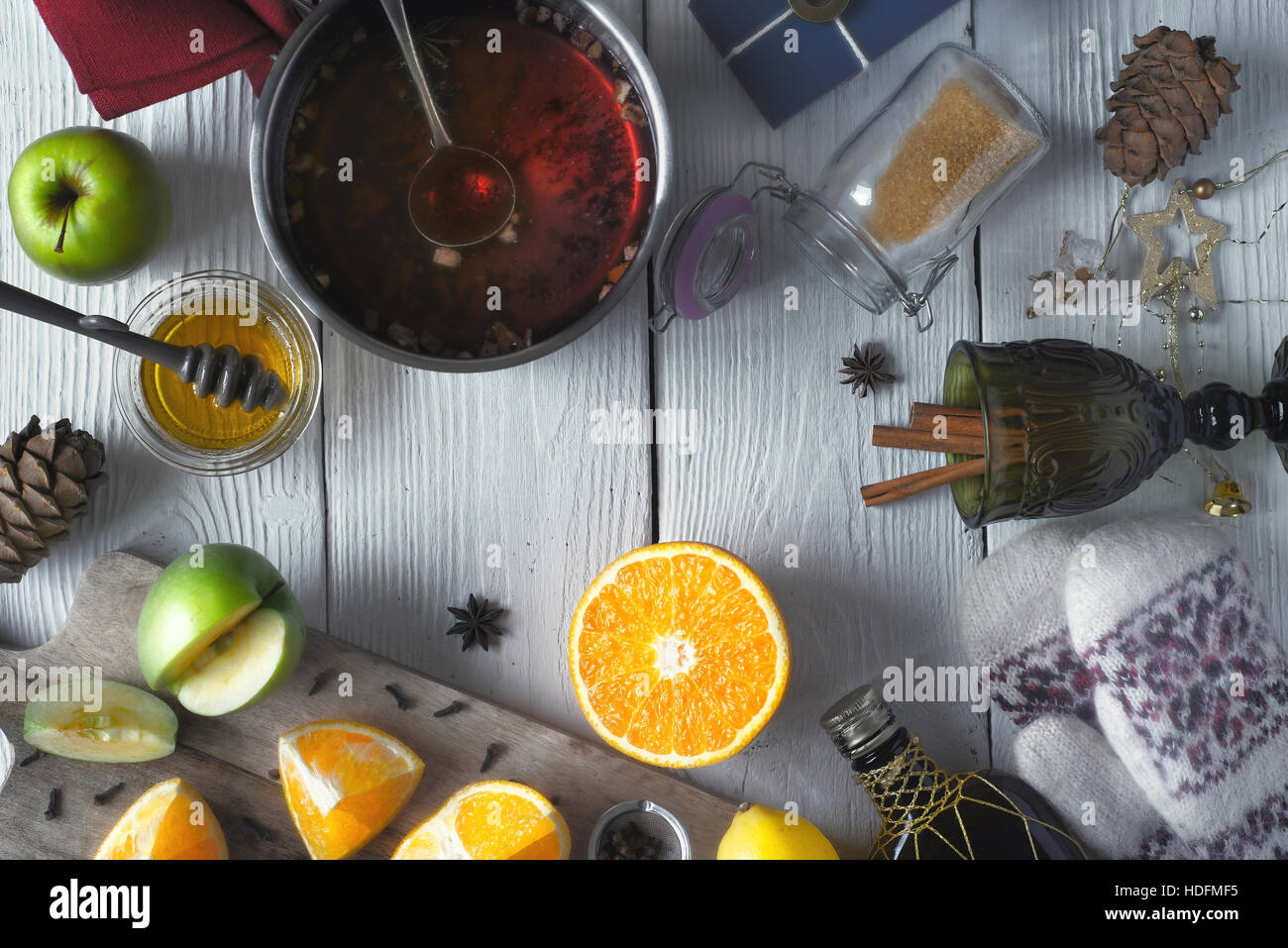 Set for mulled wine preparation on the white wooden table top view - Stock Image