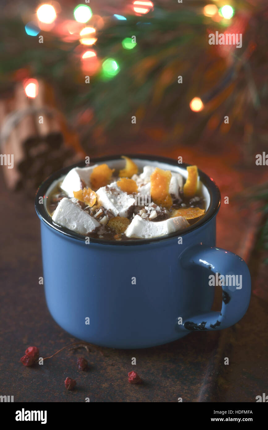 Hot chocolate with orange and marshmallows on the brown background  vertical - Stock Image