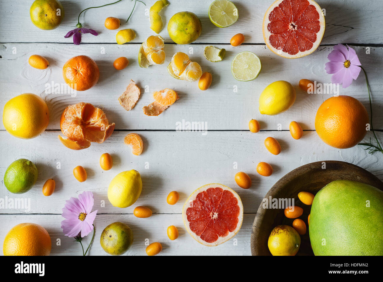 Citrus mix on the white wooden background  horizontal Stock Photo