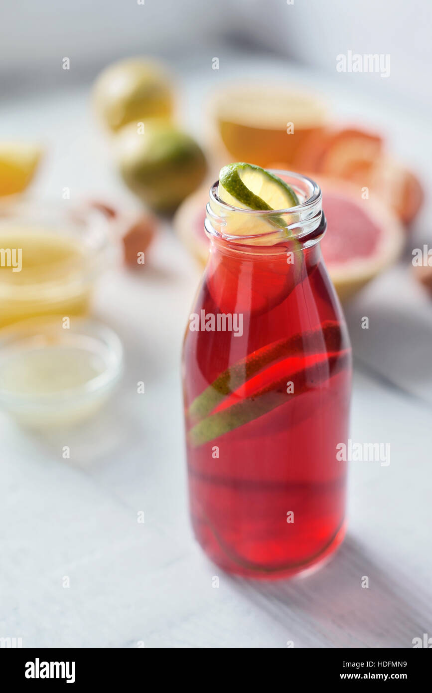 Citrus juice on the white wooden table vertical - Stock Image