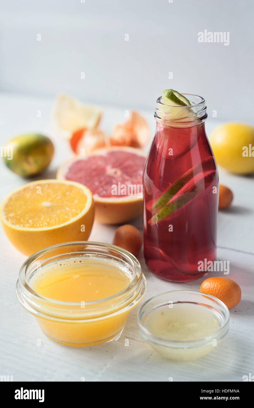 Detox citrus cocktail on the white wooden table vertical - Stock Image