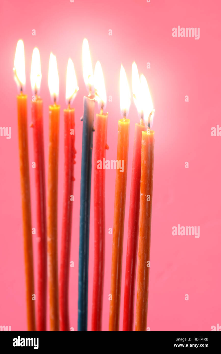 Hanukkah  burning candles on the pink background vertical - Stock Image