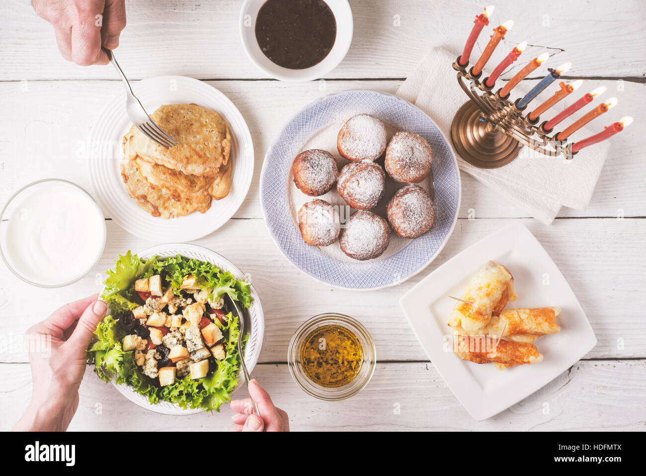 Hanukkah dinner with traditional dishes top view - Stock Image