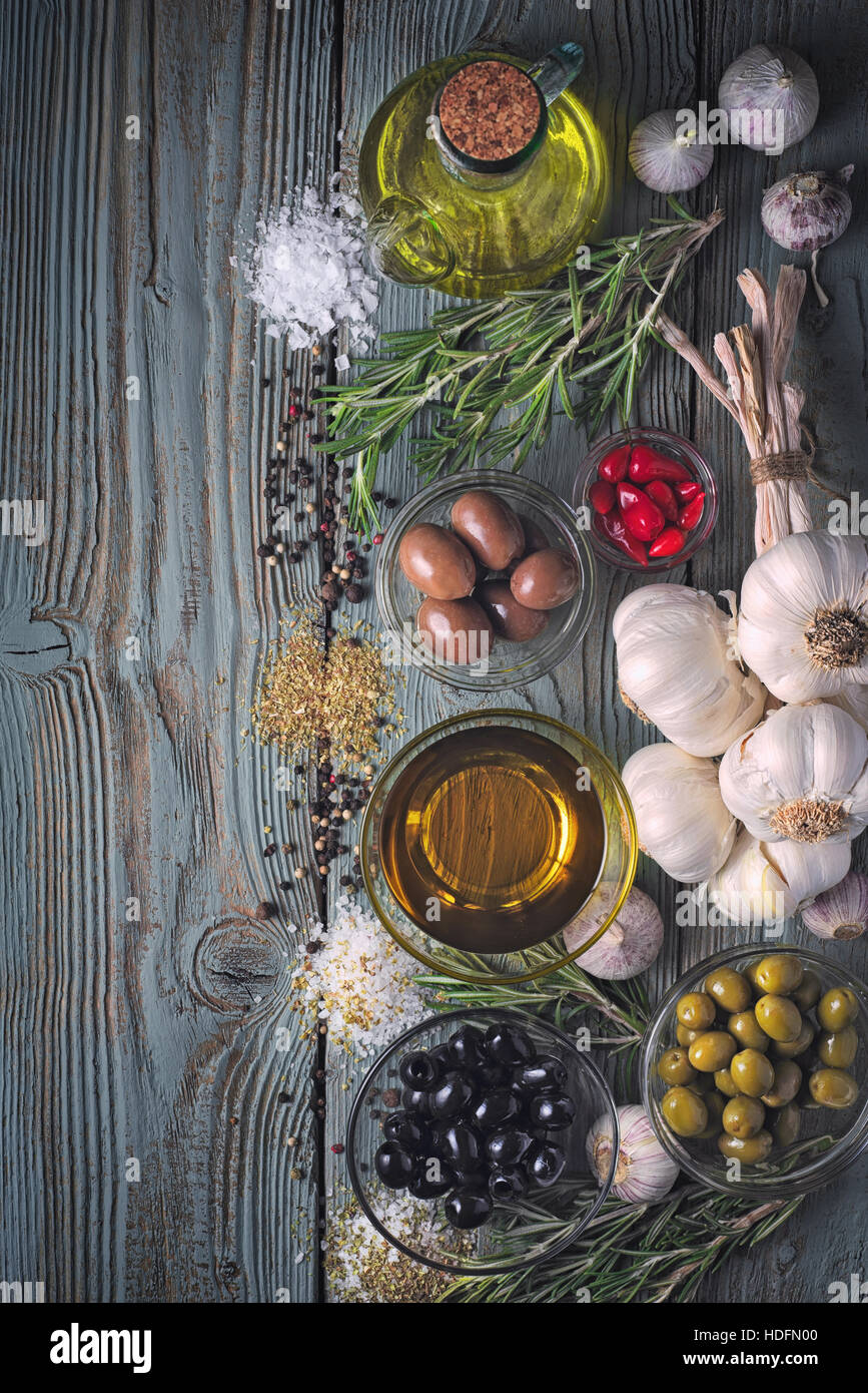 Olives with seasoning mix on the blue wooden table vertical - Stock Image