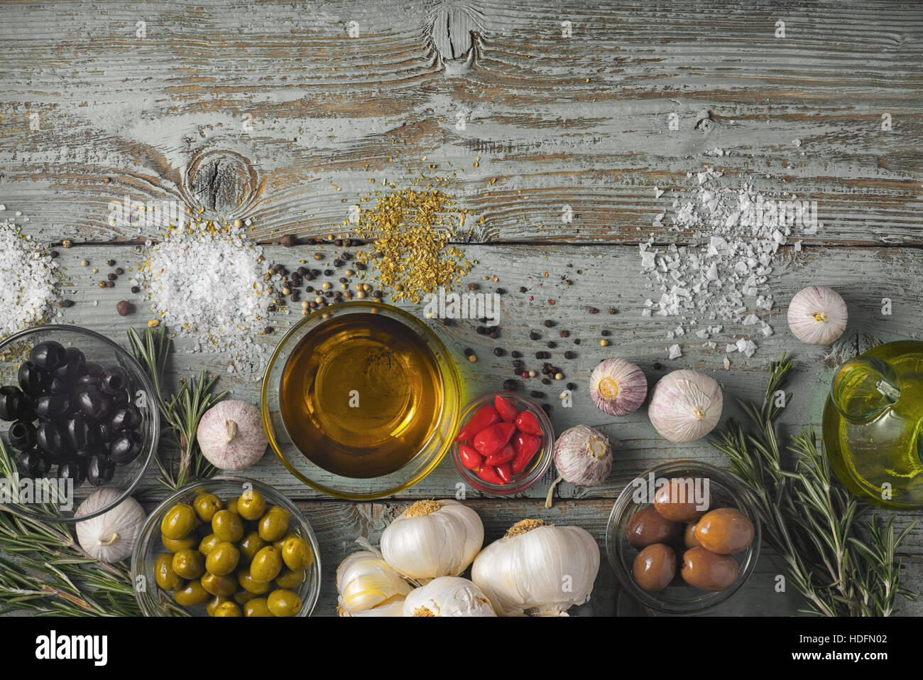 Olives with seasoning mix on the blue wooden table top view - Stock Image