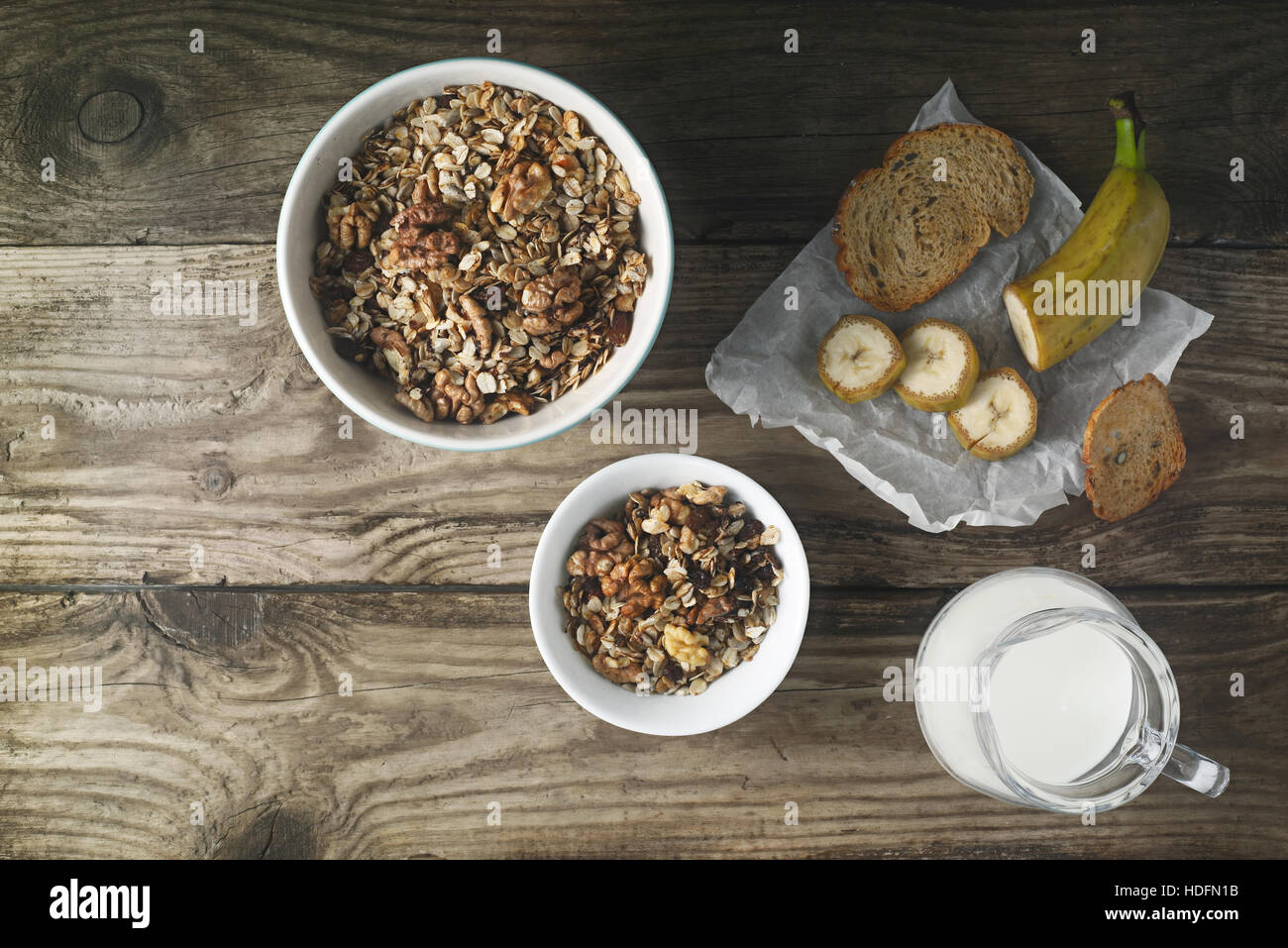 Breakfast with granola on the wooden table horizontal - Stock Image