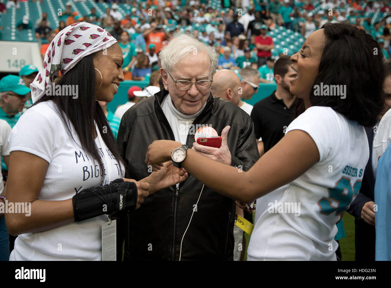 Miami Gardens, Florida, USA. 11th Dec, 2016. Warren Buffett hangs out on the Dolphins sidelines with Ndamukong Suh's Stock Photo