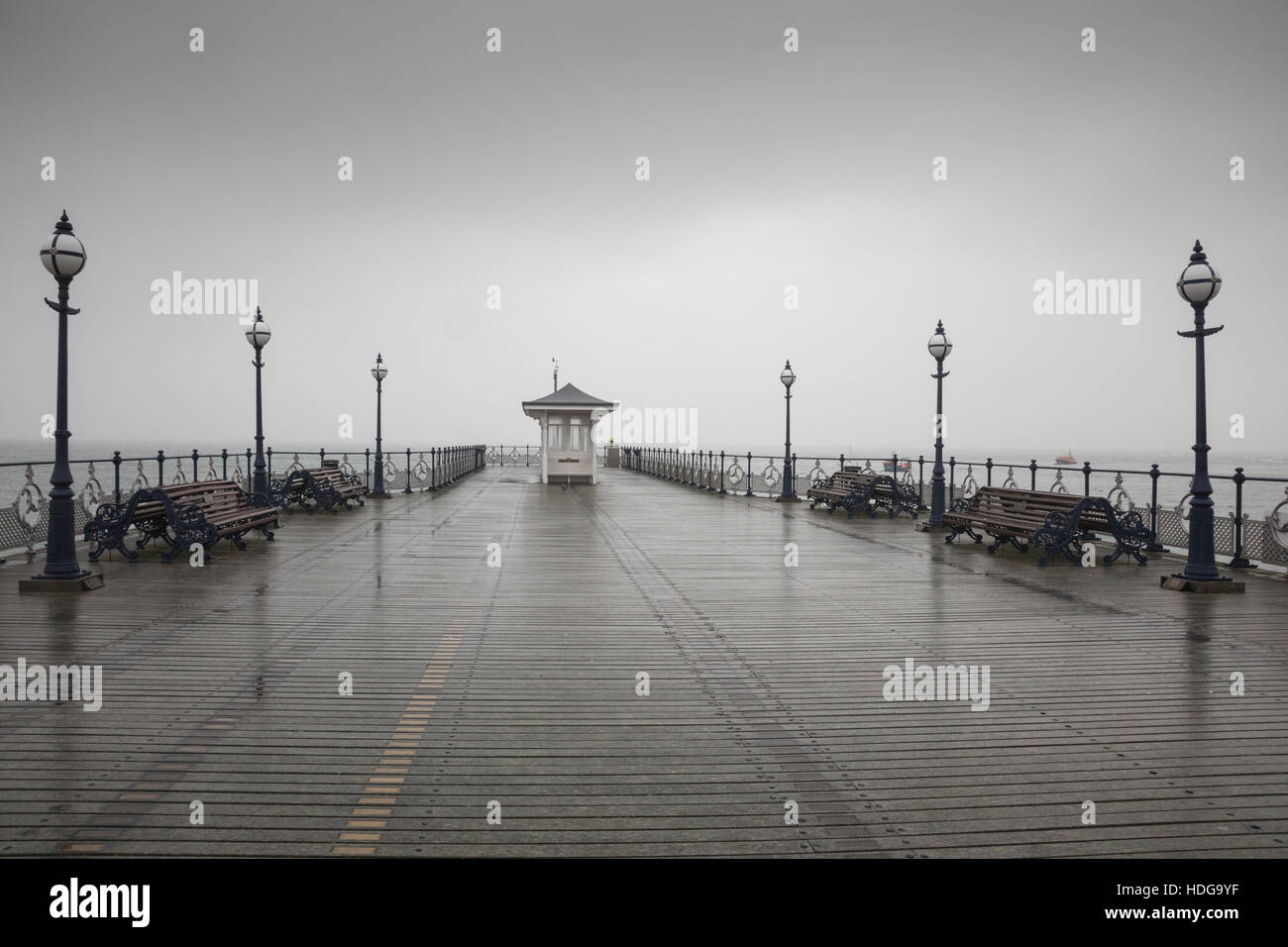 Swanage, United Kingdom. 12th December 2016. The Victorian pier in Swanage this morning after heavy rain. There - Stock Image