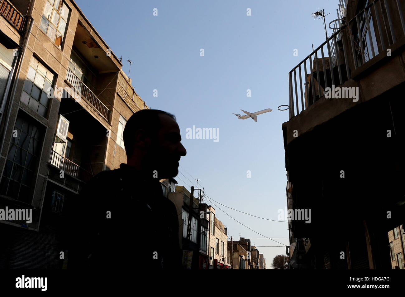 Tehran. 12th Dec, 2016. Photo taken on Dec. 12, 2016 shows an airplane of Iran Air flying over Tehran, capital of - Stock Image