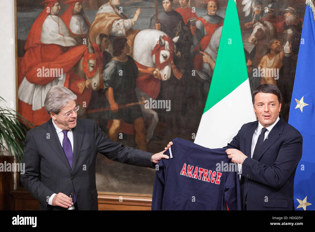 Rome, Italy. 12 December 2016. Matteo Renzi, Italy's outgoing prime minister, right, delivers a sweater reading - Stock Image