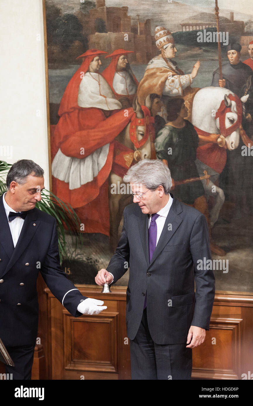 Rome, Italy. 12 December 2016. Matteo Renzi, Italy's outgoing prime minister, right, embraces Paolo Gentiloni, - Stock Image