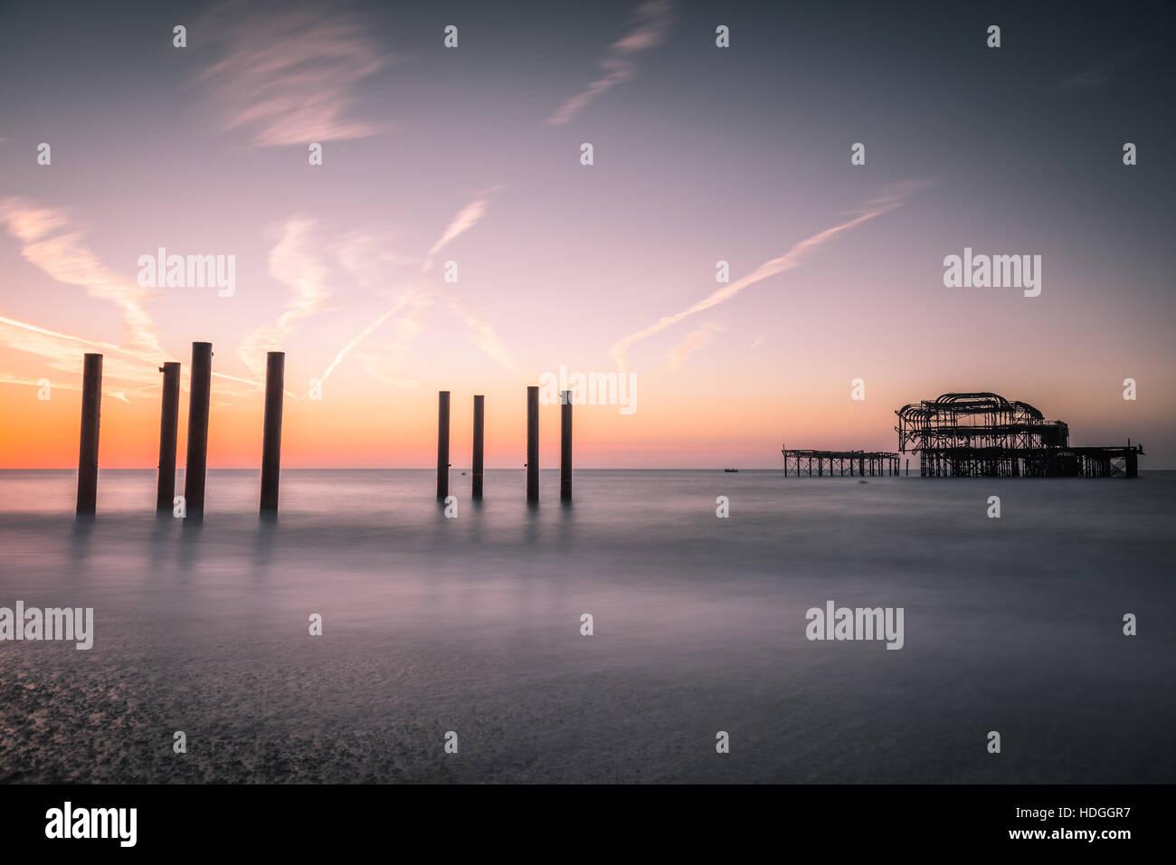 brighton west pier beach at sunrise - Stock Image