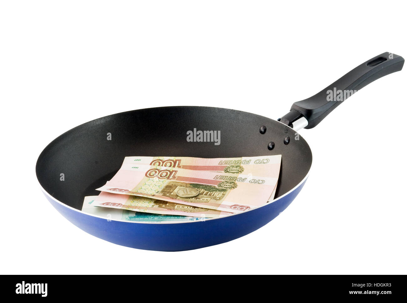 Frying pan with the russians moneys- roubles. Fried money.Top view. Isolated - Stock Image