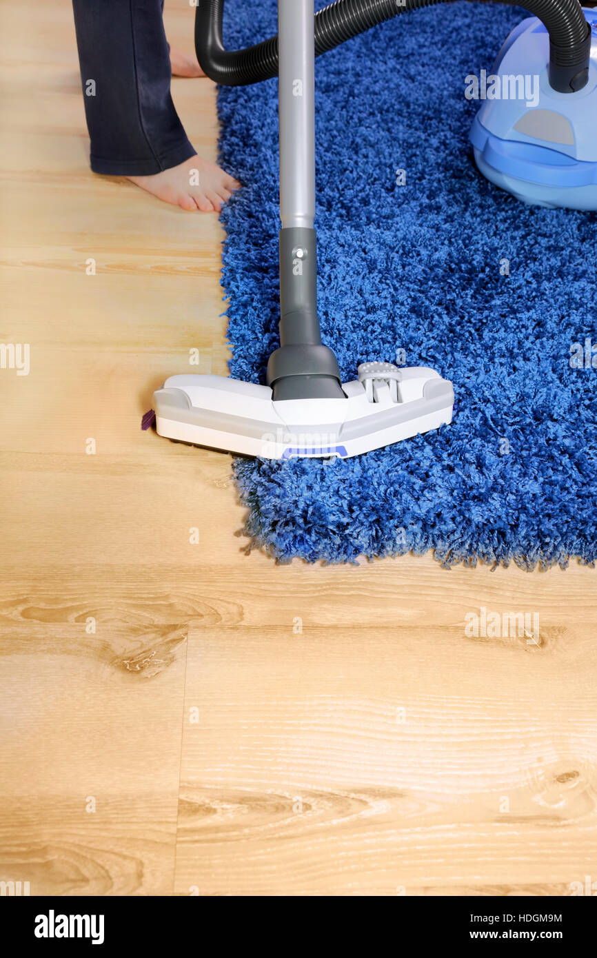 The Metal Pipe Of Vacuum Cleaner In Action Clean A Carpet And Laminated Flooring Board